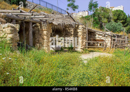 A timber built sun shade and stables in the open air museum of Nazareth Village Israel. This site gives an authentic look at the life and times of Jes - Stock Image
