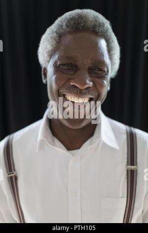 Portrait smiling, confident senior man - Stock Image