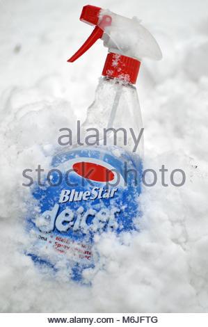 Trigger spray bottle of blue vehicle de-iced fluid - Stock Image