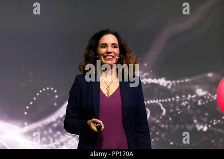. Mathematical physicist Ivette Fuentes talking about the realities of building a quantum teleporter, on the Cosmos Stage, at New Scientist Live - Stock Image