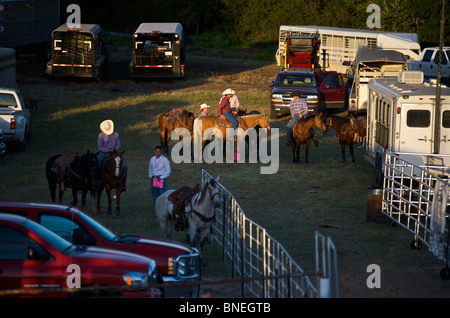 Cowboy members of PRCA preparing backstage for rodeo event in Bridgeport, Texas, USA - Stock Image