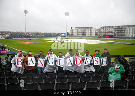 Bangladesh fans in the rain during the ICC Cricket World Cup group stage match at Bristol County Ground. - Stock Image