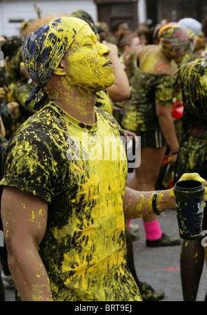 Nottinghill Carnival 2010. Reveler Covered in Yellow Paint. - Stock Image