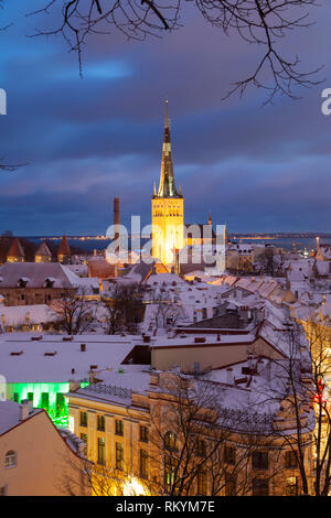 Winter dawn in Tallinn old town with St Olaf's church dominating the skyline. - Stock Image