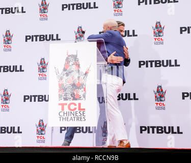 Pitbull is honoured with a hand and footprint ceremony at the TCL Chinese Theatre  Featuring: John Travolta, Pitbull, Armando Christian Perez Where: Los Angeles, California, United States When: 14 Dec 2018 Credit: Sheri Determan/WENN.com - Stock Image