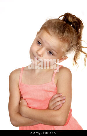 Six year old girl with quizzical, bored or wry smile look - Stock Image