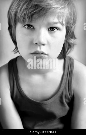 Portait of cute blond boy, black and white photograph - Stock Image