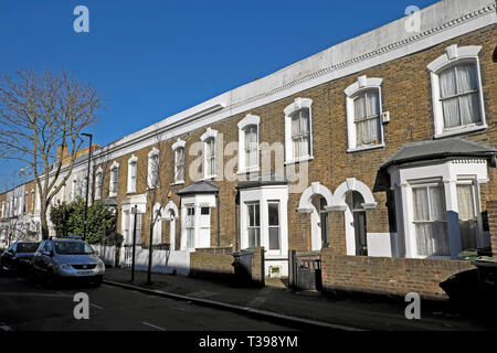 Row of terraced housing on Hargwyne Street in Brixton, South London SW9 England UK  KATHY DEWITT - Stock Image