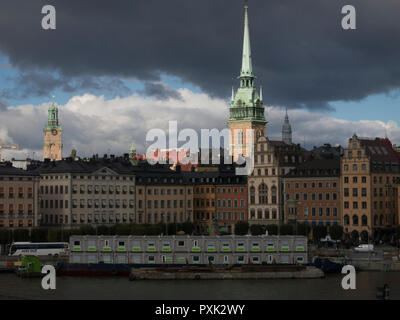 Dark clouds over Stockholm Old Town as seen from Slussen - Stock Image