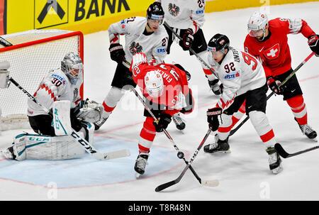 Bratislava, Slovakia. 14th May, 2019. L-R DAVID KICKERT, LUKAS HAUDUM (both AUT), KEVIN FIALA (SUI), CLEMENS UNTERWEGER (AUT) and VINCENT PRAPLAN (SUI) in action during the match Switzerland against Austria at the 2019 IIHF World Championship in Bratislava, Slovakia, on May 14, 2019. Credit: Vit Simanek/CTK Photo/Alamy Live News - Stock Image