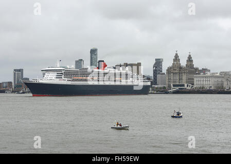 The Three Queens festival on the River Mersey. Three Cunard cruise ships visiting Liverpool UK - Stock Image
