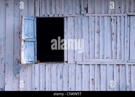 Open Window hatch in a wooden wall. Kalaw, Burma - Stock Image