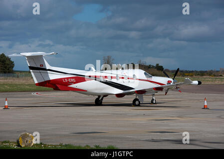 PC12 Single engined Luxumbourg registered Business Aircraft at Inverness Airport, Highland Region. Scotland. - Stock Image