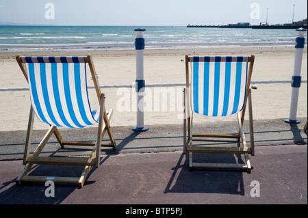 Deckchairs on Weymouth Beach, Dorset, UK - Stock Image