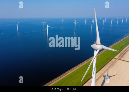 WindTurbines in a blue sea on a sunny day - Stock Image