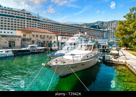 A busy afternoon at the Boka, port of Kotor Montenegro as various boats, yachts, rafts and a large cruise ship share space in the mediterranean city - Stock Image