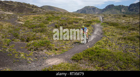 Mountain biker on the Path of desolation, Osorno Volcano, Chile, South America. - Stock Image