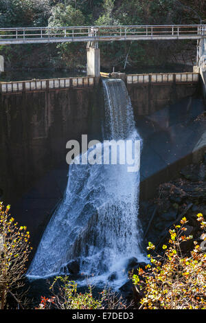 Tuckasegee Lake dam spillway in the West Fork Tuckasegee River along scenic route NC 107 in mountains of SW North - Stock Image