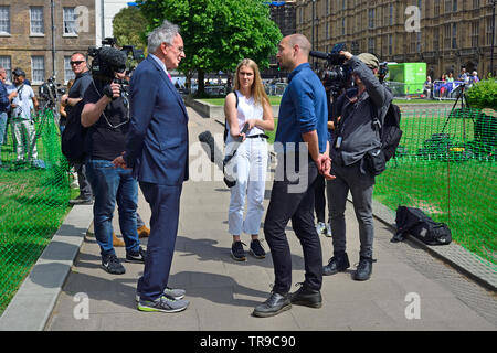 Peter Bone MP (Con: Wellingborough) being interviewed on College Green, Westminster 24th May 2019, the day Theresa May announced her intent to resign - Stock Image