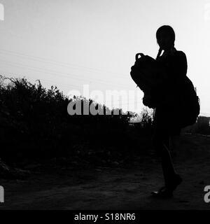 Walking schoolgirl silhouette - Stock Image