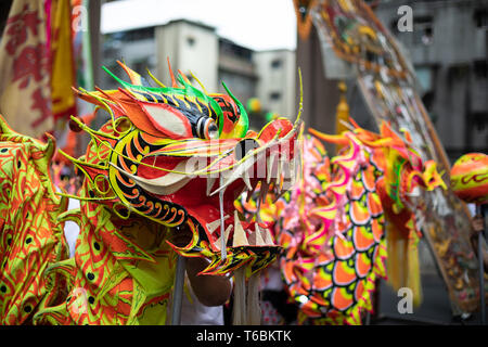 The head of a dragon used in dragon dances during a Daoist Mazu procession through the streets of Taipei in a show of practical, living religion. - Stock Image