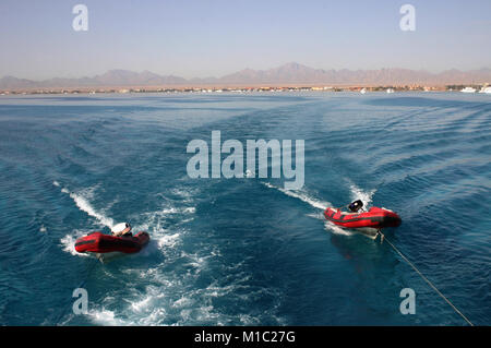 Inflatable rubber boat tied to the boat, Red Sea, Egypt - Stock Image
