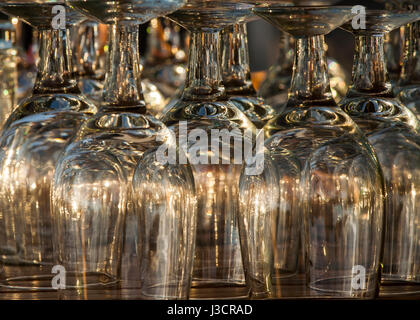 Reflection patterns on upside down water goblets warm tone - Stock Image