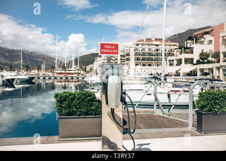 Montenegro, Tivat, April 9, 2019: Modern Tesla electric filling station in the port of Porto Montenegro for refueling electric cars and vehicles. - Stock Image