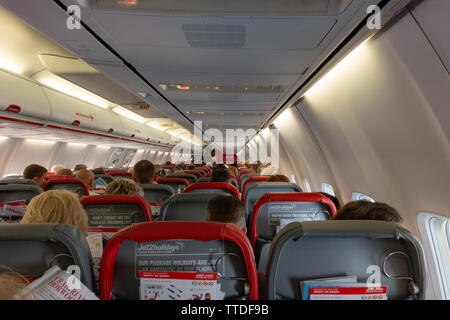 Inside view from a passengers seat of a  Boeing 737 aircraft - Stock Image