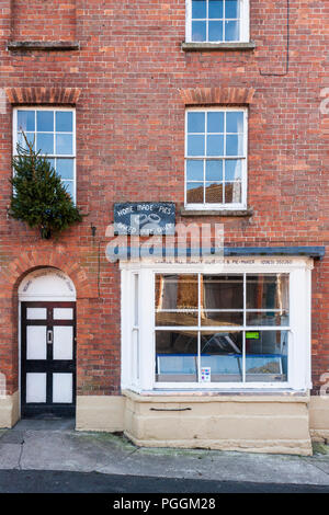Village butcher's shop store front in country village of Castle Cary, Somerset, England, GB, UK. - Stock Image
