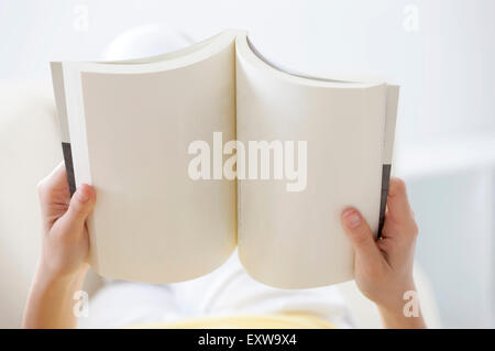 Young woman holding a book, - Stock Image