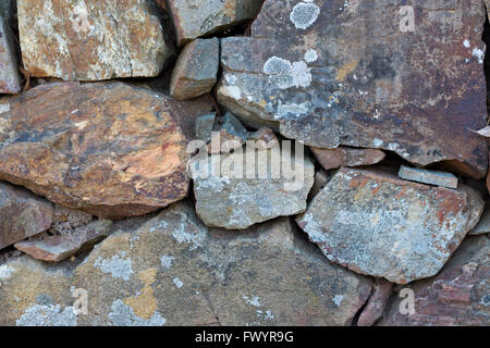 Close up of multi coloured rock fence. - Stock Image