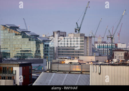 Dawn first light Manchester skyline from above looking to tower cranes in  Salford and 1 Deansgate left and the Radisson hotel middle - Stock Image