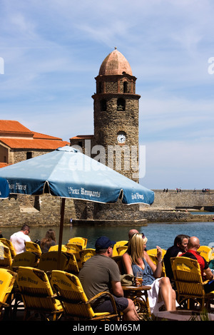 tourists relaxing at charming seaport village of Collioure France - Stock Image