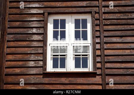 The external window and wall of a vintage wood house in the American West . - Stock Image