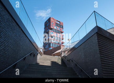 Anodized aluminum cladding panels of ochre, russet and burgundy red used on the Cinnamon Tower building, Osakaallee, HafenCity, Hamburg, Germany. - Stock Image