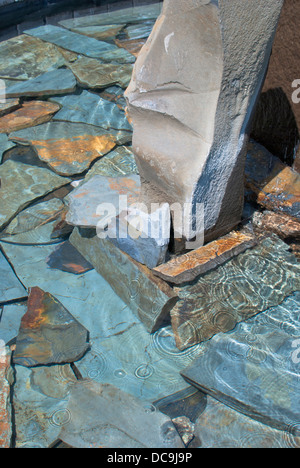 Rock in a water fountain in Coeur d'Alene, Idaho, USA. - Stock Image