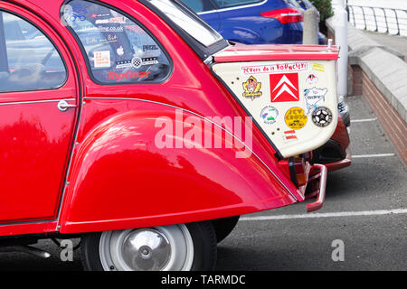 Red Citroen 2CV with trunk. - Stock Image