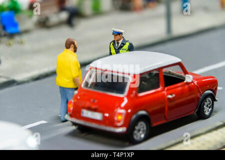 Miniature model of a driver stopped by a police officer, at Kolejkowo, Wrocław, Wroclaw, Wroklaw, Poland - Stock Image