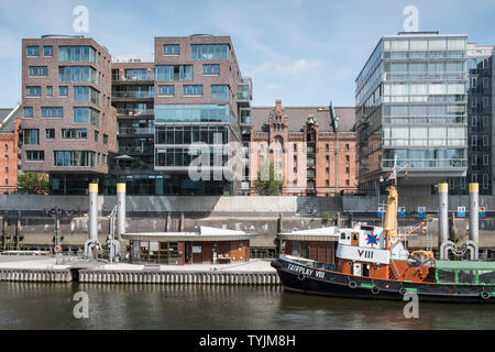 Sandtorhafen harbour, with its mix of modern architecture and mooring for historical ships, Hafencity, Hamburg, Germany. - Stock Image