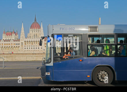 public bus and parliament in the background, Budapest, Hungary - Stock Image