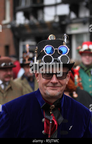 Rochester, Kent, UK. 1st December 2018: A parade participant in Steampunk custume takes part in the main parade. Hundreds of people attended the Dickensian Festival in Rochester on 1 December 2018. The festival's main parade has participants in Victorian period costume from the Dickensian age. The town and area was the setting of many of Charles Dickens novels and is the setting to two annual festivals in his honor. Photos: David Mbiyu/ Alamy Live News - Stock Image