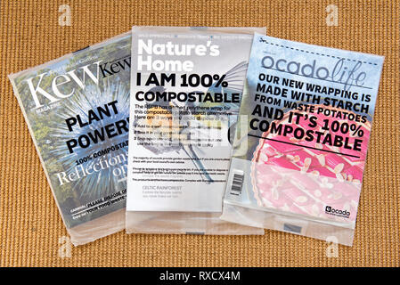Selection of magazine in compostable covers or packaging including RSPB's Nature's Home, Kew magazine and Ocado Life on sitting room floor. - Stock Image