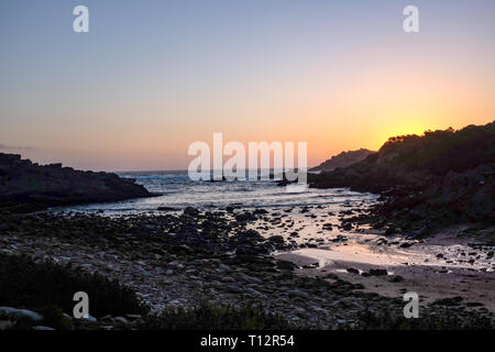 A sunset over the Indian ocean along the Otter Trail, South Africa's most famous and beautiful hiking trail in the Western Cape - Stock Image