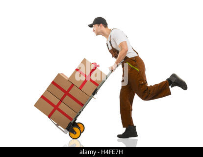 Courier runs - the trolley: packages and gifts - Stock Image