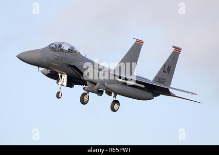 Banked approach on the RAF Lakenheath approach by a resident 494th Fighter Squadron F-15E. - Stock Image