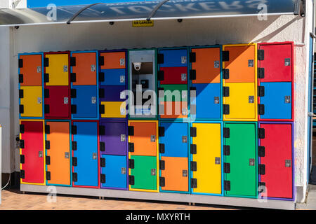 Surfers Paradise, Gold Coast, Australia, colourful secure lockers for use by those swimming in the ocean or storage of other thing while shopping in t - Stock Image