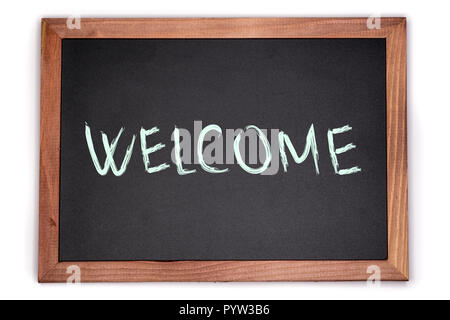 WELCOME sign written on chalk board. Isolated blackboard with wooden frame. - Stock Image