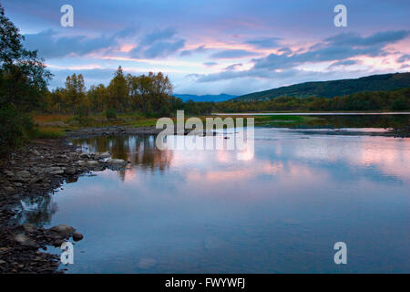 Blue hour at river Kaperelva near Silsand on island Senja in northern Norway. - Stock Image