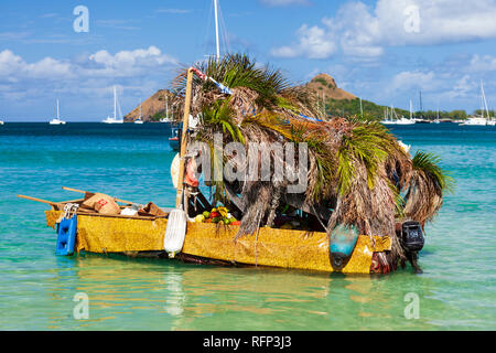 Floating fruit shop shanty boat, Reduit Beach Rodney Bay, Saint Lucia, Caribbean. - Stock Image